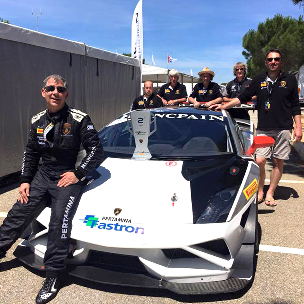 topcats racing team celebrating 2nd racing position finish with white and black lamborghini gallardo