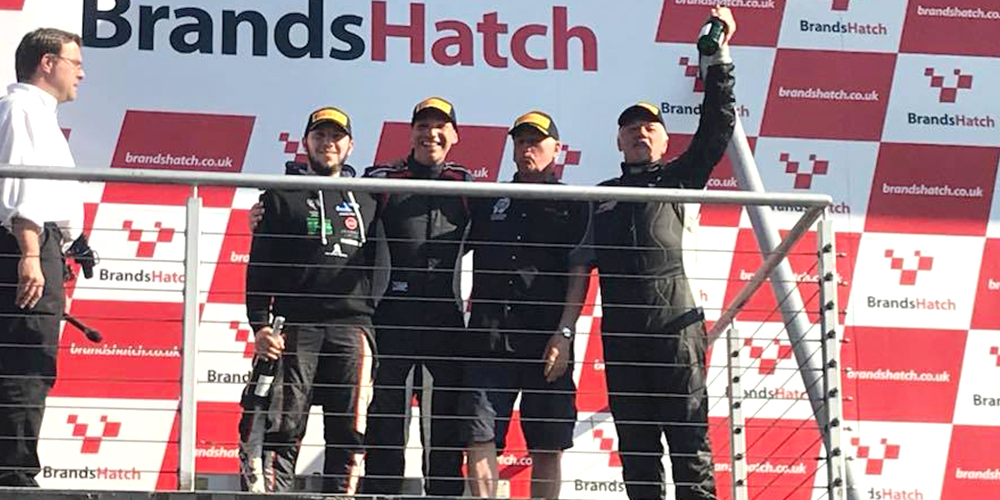 topcats racing team celebrating on podium at brands hatch