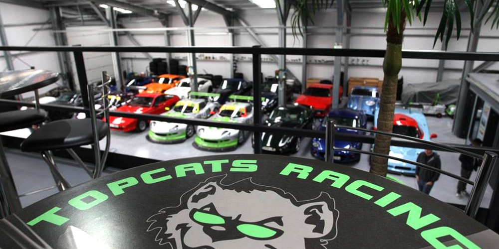 overhead view of topcats racing workshop from balcony waiting area and cafe