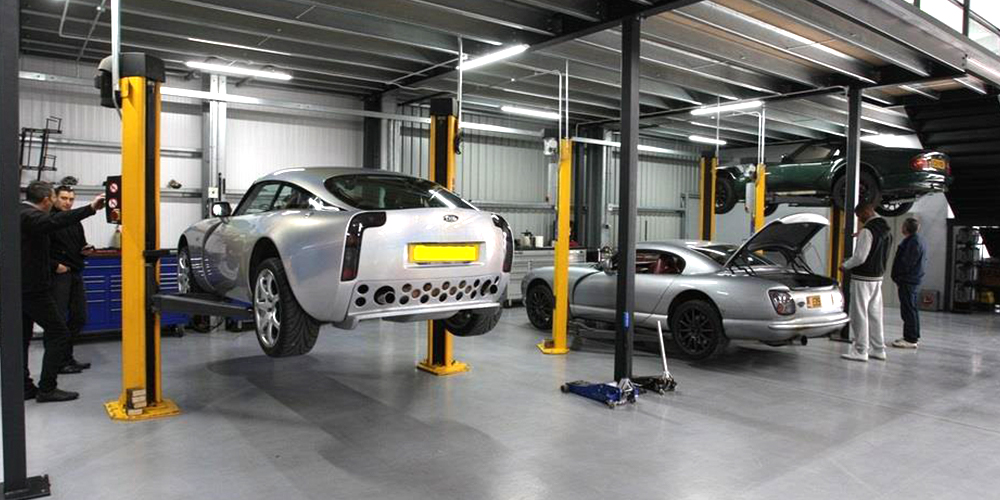 photo of silver tvr 350 on topcats racing ramp and silver tvr cerbera with boot open