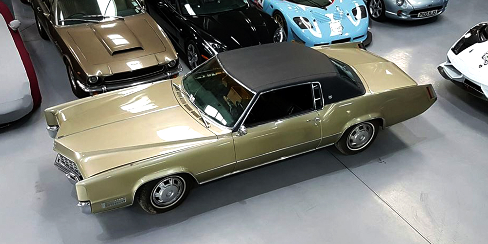 champagne coloured cadillac deville in topcats racing workshop