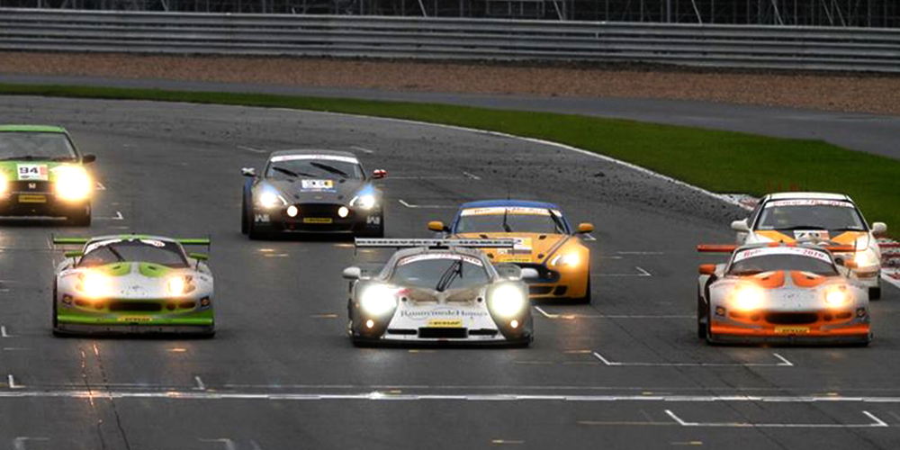 topcats racing marcos mantis' and mosler mt900 crossing finish line together at event