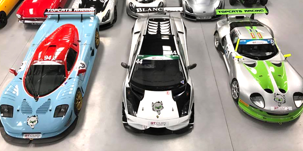 overhead view of topcats racing performance cars including marcos mantis, mosler mt900 and lamborghini gallardo