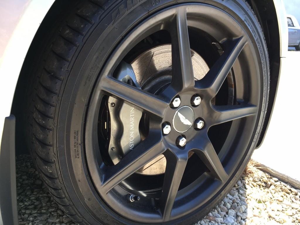 close up of silver Aston Martin V8 Vantage (2006) wheel and brake calliper at topcats racing workshop