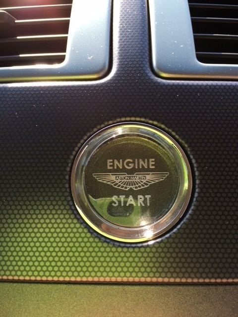 close up of silver Aston Martin V8 Vantage (2006) engine start button at topcats racing workshop