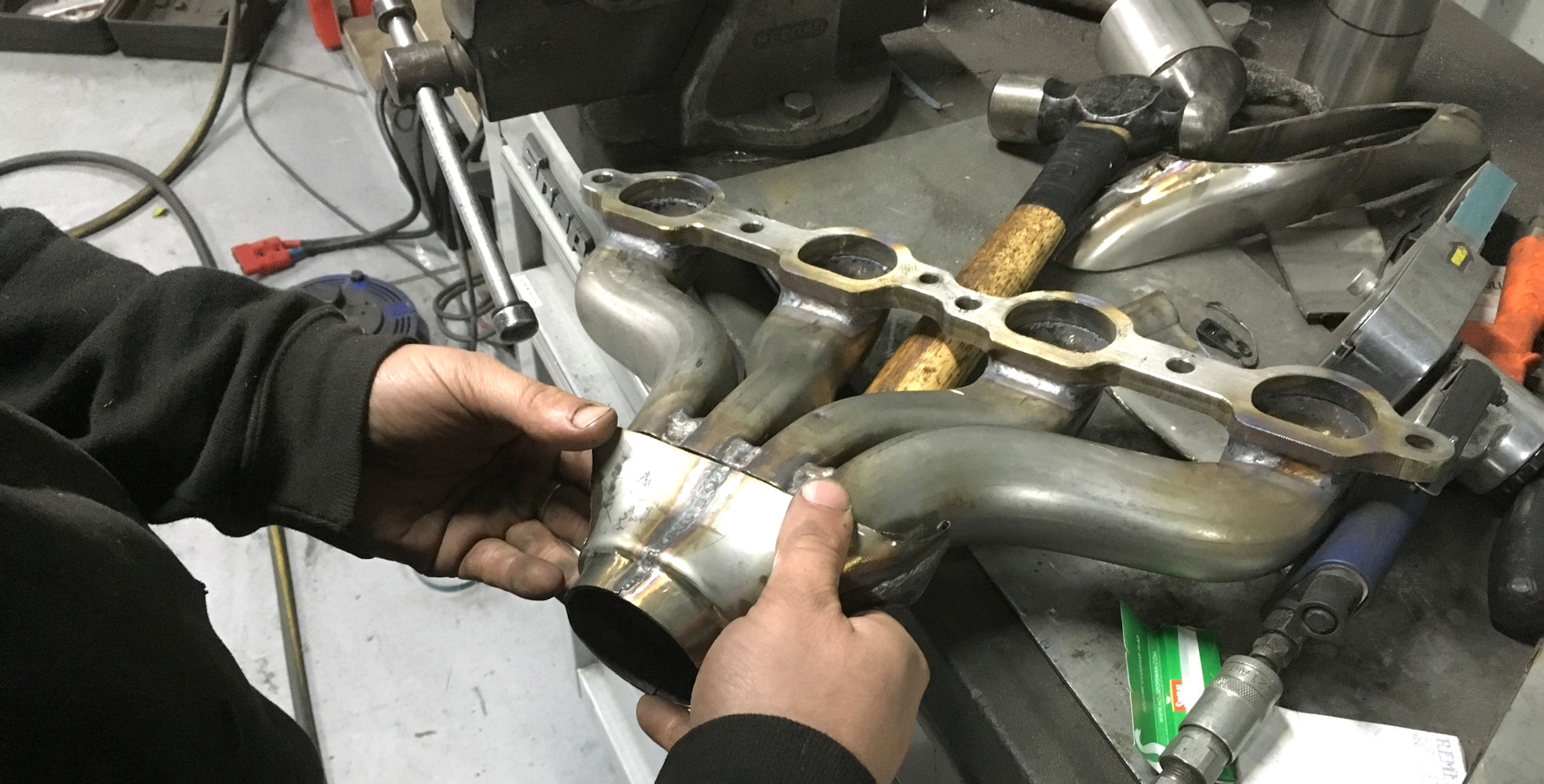 exhaust manifold being modified at topcats racing workshop