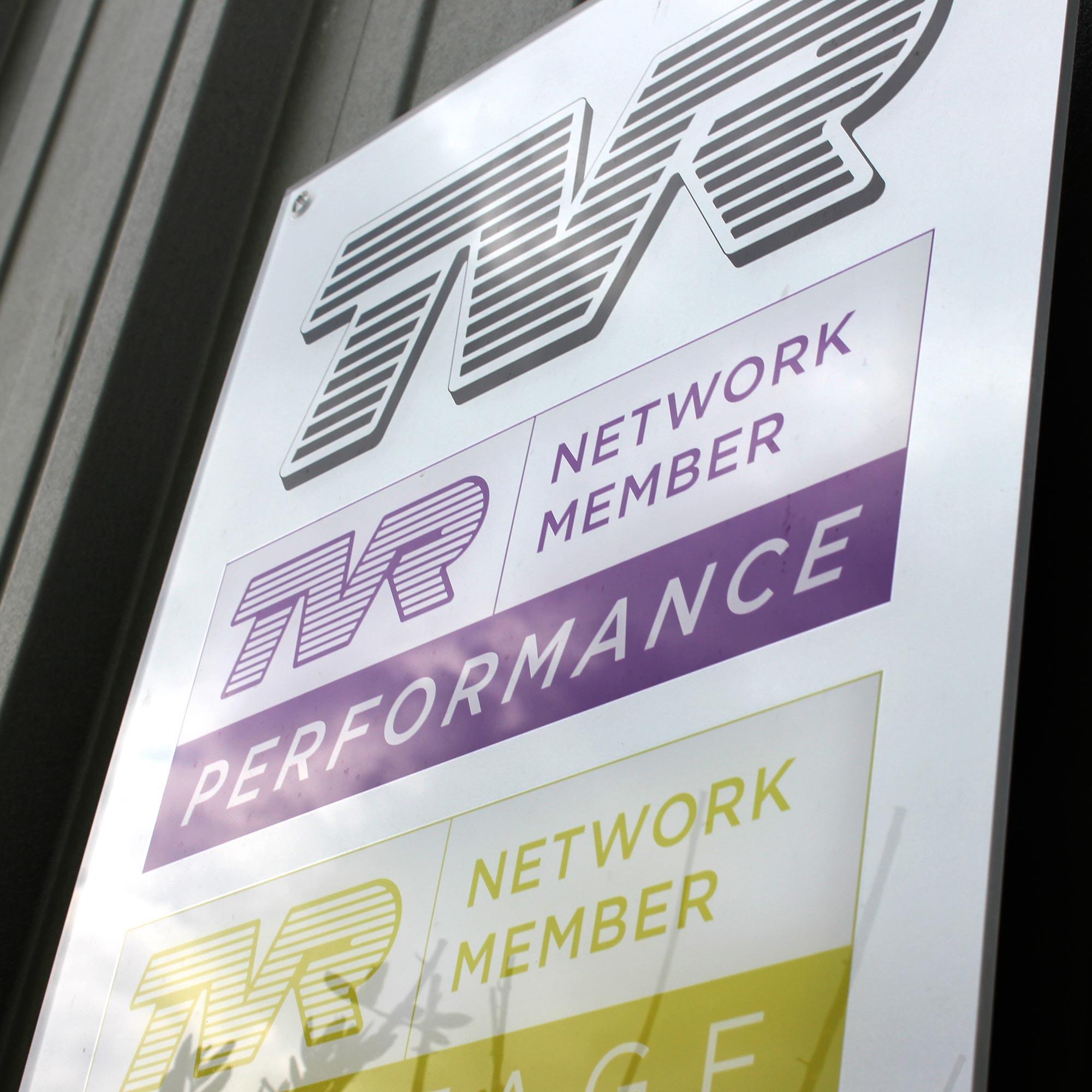 tvr network member signage outside topcats racing workshop