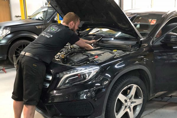 topcats team member working on mercedes road vehicle