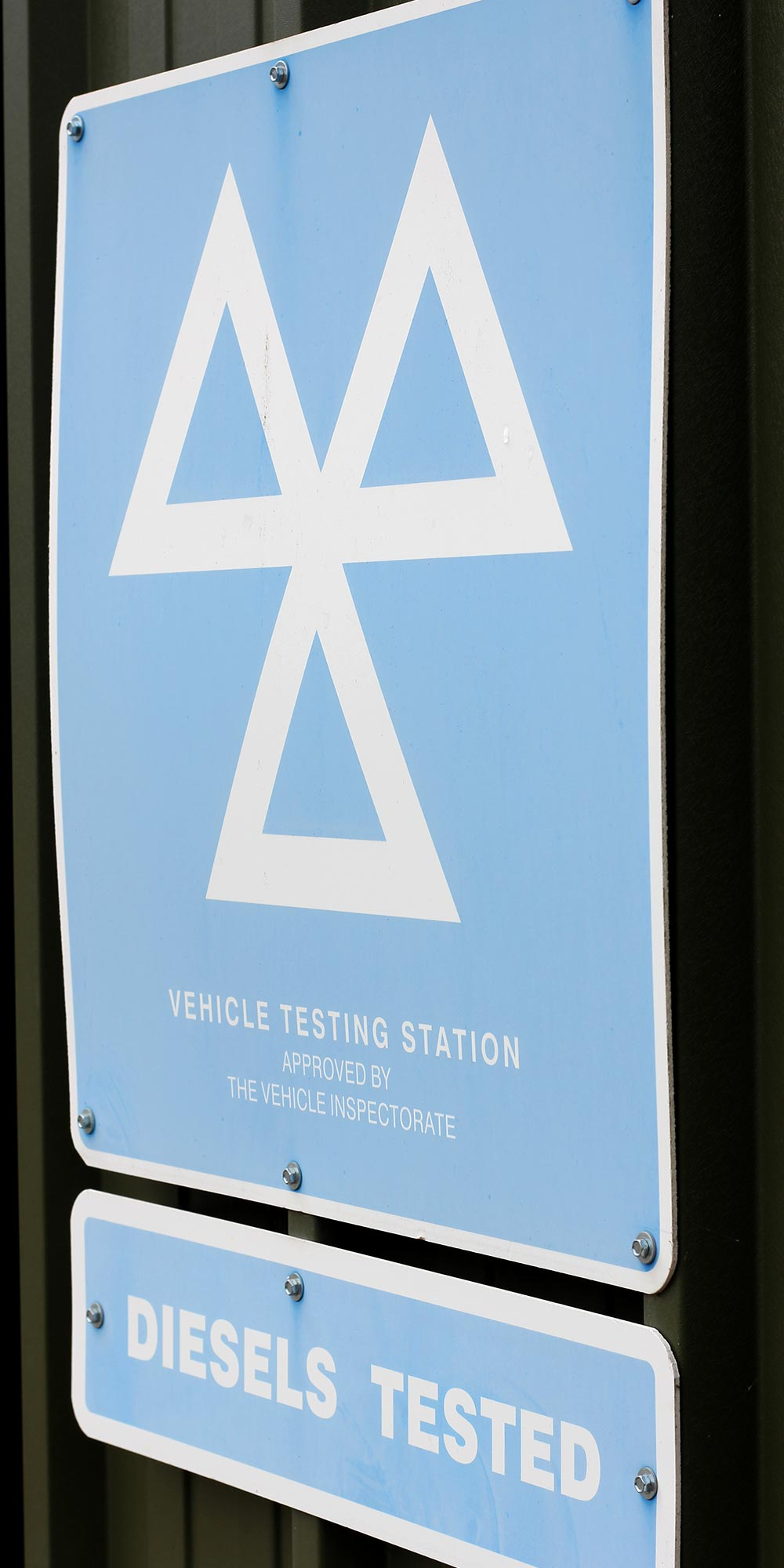 mot vehicle testing station sign at topcats racing workshop