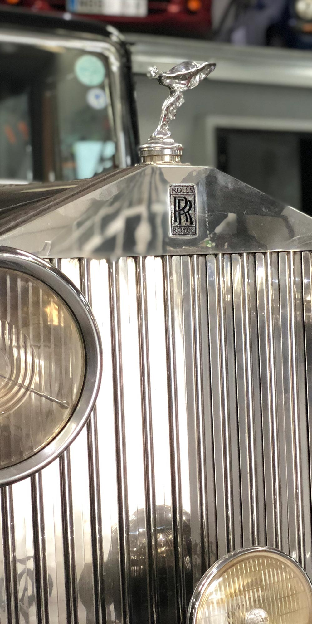 close up of rolls royce radiator grill and emblem