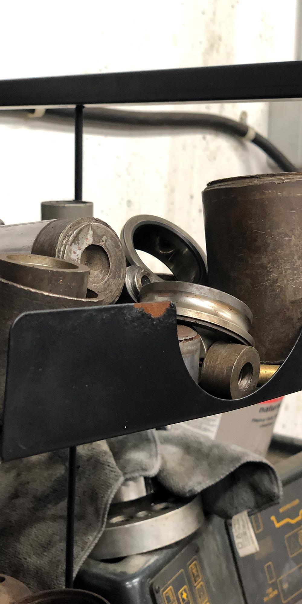 close up of a variety of press tools at topcats racing workshop