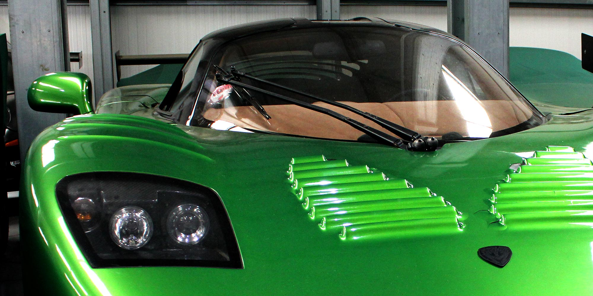 metallic green mosler mt900 at topcats racing workshop