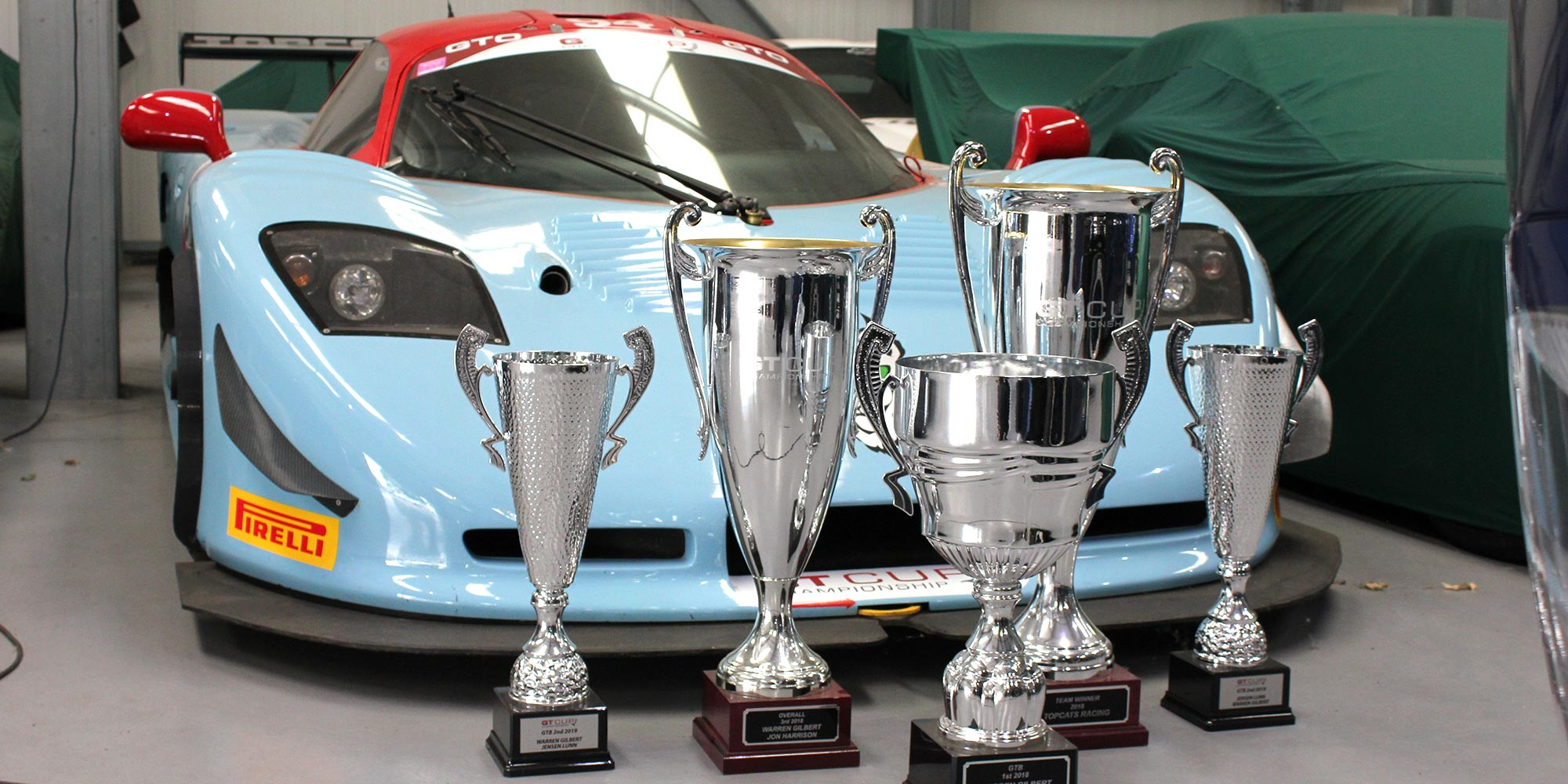cluster of trophies in front of mosler mt900