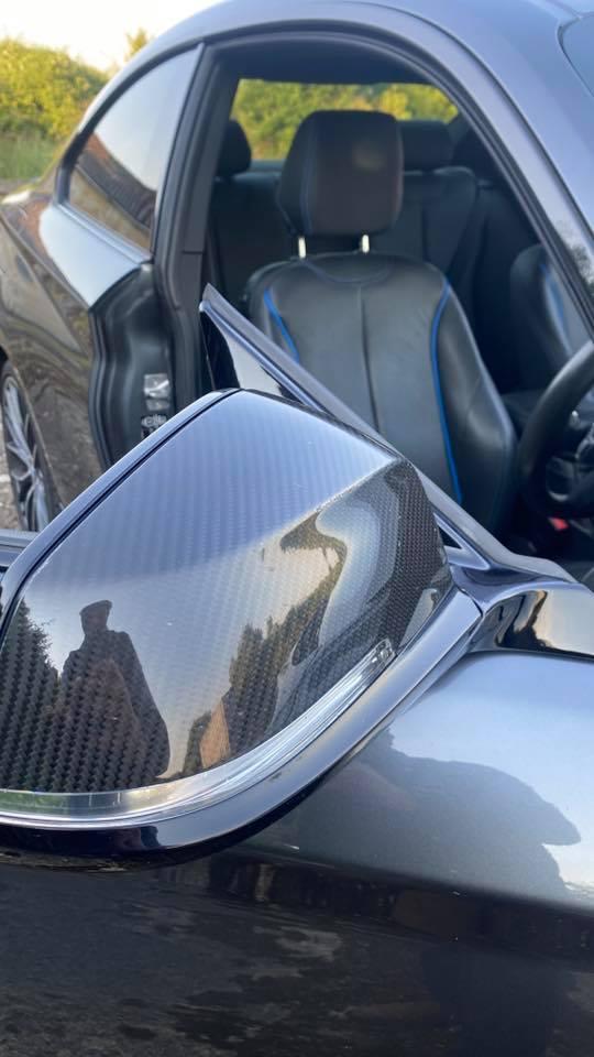 close up of carbon fibre wing mirror on BMW M225d M Sport (2014)