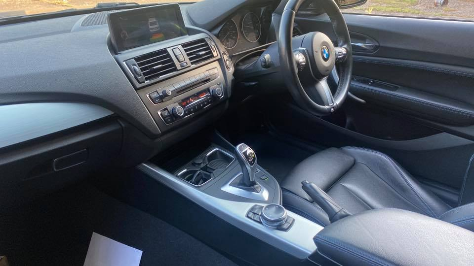 close up of BMW M225d M Sport (2014) dashboard and interiors at topcats racing workshop