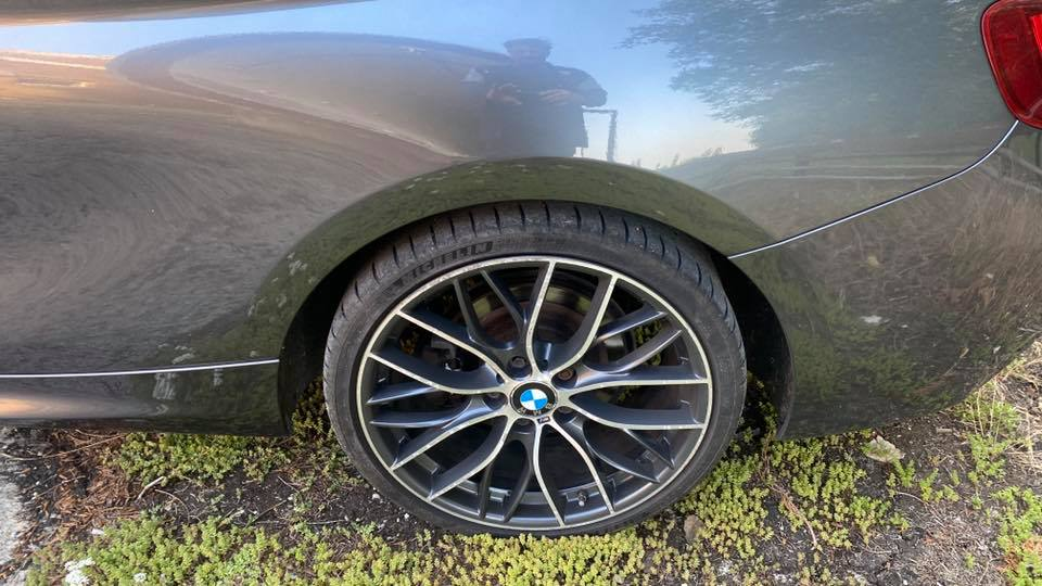 close up of BMW M225d M Sport (2014) wheel at topcats racing workshop